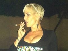 Big tits enjoying a cigar