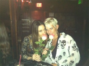 Two Girls Smelling Pink Roses