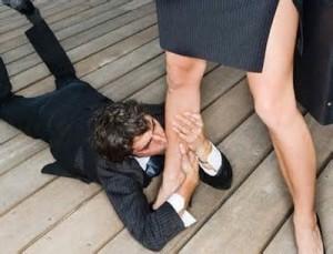 man kissing womans feet